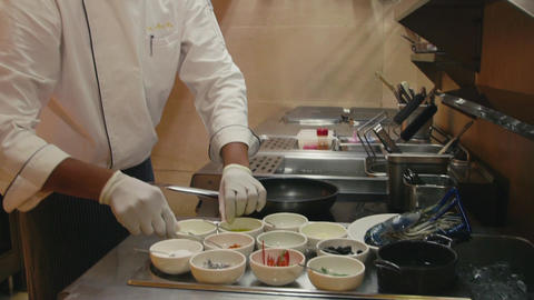 Professional Chef Preparing Food In Restaurant Kit Footage