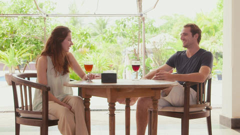 Young Man And Woman Relaxing In Bar Live Action