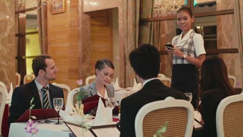 Group Of Men And Women Eating In Luxury Restaurant Footage