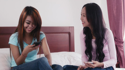 Asian Girls Using Smartphone For Facebook And Soci Footage