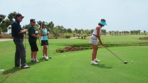 Group Of Men And Women Playing Golf GIF