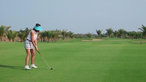 Woman Hitting Ball In Golf Club Footage