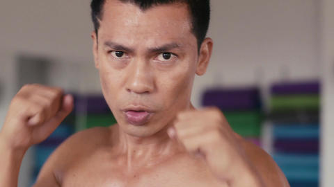 Portrait Of Aggressive Fighter Punching In Boxing Gym Footage