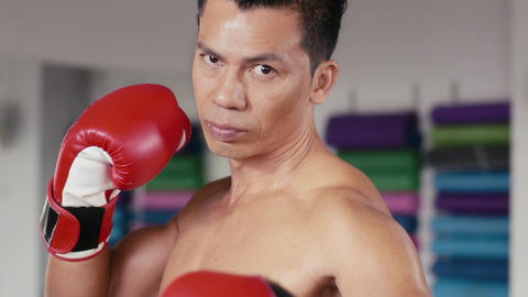 Portrait Of Asian Man In Boxing Gym And Looking At Camera GIF