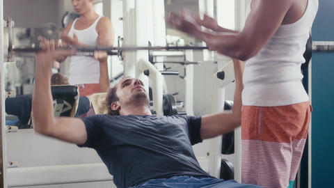 Man And Personal Trainer Exercising In Wellness Class Footage
