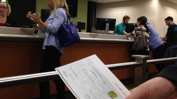Woman holding a cheque inside TD bank Footage