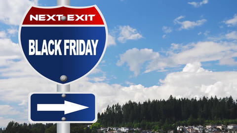 Black friday road sign with flowing clouds Footage