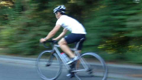 Man Riding Bicycles stock footage