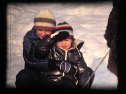 Two Girls And Mother In Winter, Snow Sled Fun stock footage