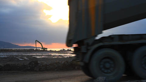 Dump truck and a hydraulic excavator working at co Footage