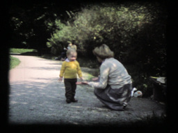 Toddler And Mother, First Steps On Gravel Path stock footage