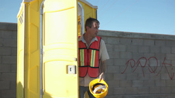 Male Construction Worker Portable Bathroom Close Footage