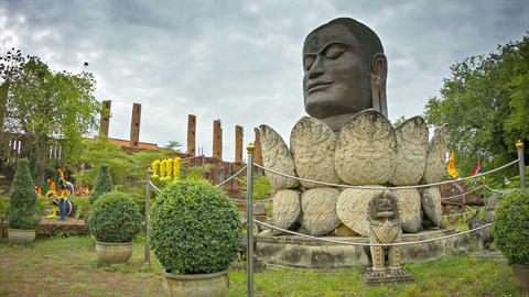 Head of Buddha in a lotus flower. Monument in Ayut Live Action