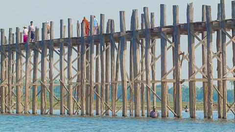 MANDALAY. MYANMAR - 13 JAN 2014: U Bein Bridge acr Footage