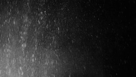 Splashes of water on a black background Footage