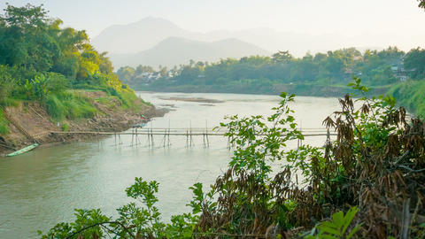 Old bamboo bridge across the river. Laos. Luang Pr Footage