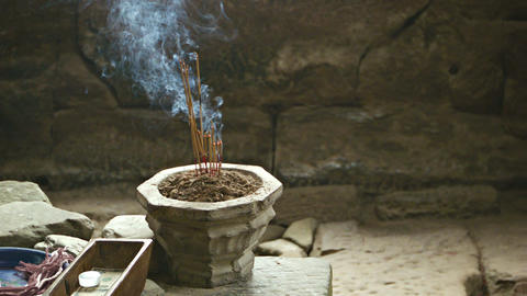 Stone bowl with incense sticks in the room of the  Footage