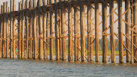 Pillars of the old wooden bridge. Burma. Mandalay Footage