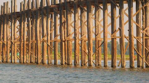 Pillars of the old wooden bridge. Burma. Mandalay Footage