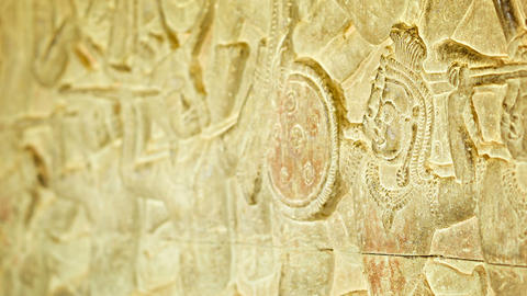 Ancient carvings on the walls of Angkor Wat. Cambo Footage