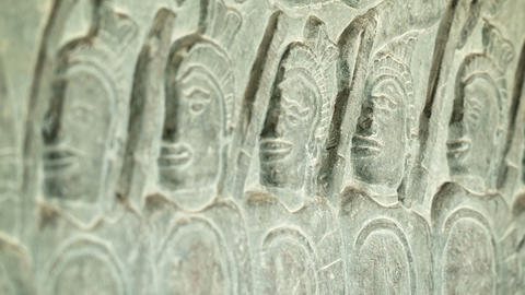 Ancient carvings on the walls of Angkor Wat close  Footage