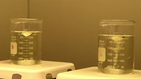 Two beakers with water inside Footage