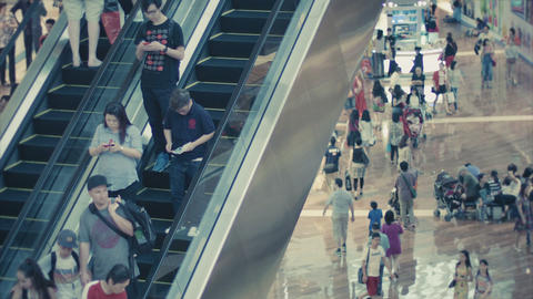 SINGAPORE - DEC 31 2013: A crowd on the escalator Footage