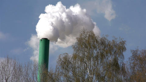 A white thick smoke coming out a factory Footage