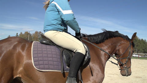 A lady in blue jacket doing a horse riding Footage