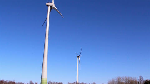 Two windmills on a wide field Footage