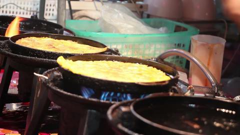 banana pancake cooking in night thai market Footage