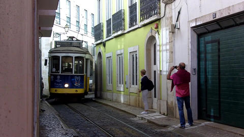 Lisbon Yellow Tram and Tourists Live Action