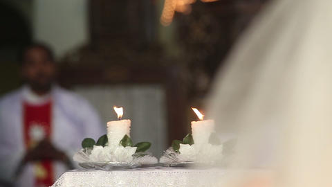 before the bride at the altar candles are lit and  Footage