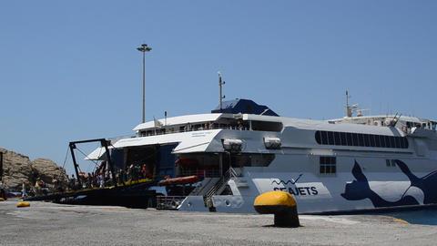 Passengers leaving ferry in Mykonos Port, Greece Footage