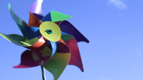 Child's windmill against sky Stock Video Footage