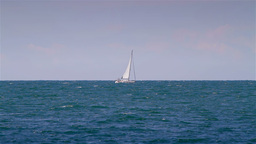 Seascape with small boats passing Stock Video Footage