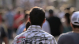 Crowded street, unrecognizable people walking Stock Video Footage