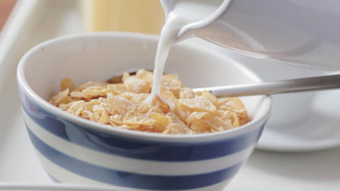 Pouring milk on cereal Stock Video Footage