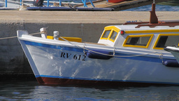 Small boat in Rovinj Harbor, Croatia Stock Video Footage