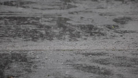 Raindrops in puddles Stock Video Footage