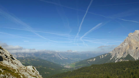 time lapse contrails over dolomites valley 11524 Footage