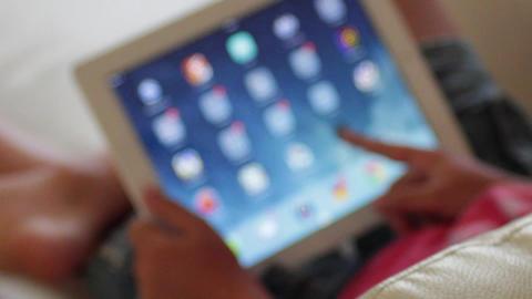 Kid using an iPad Footage
