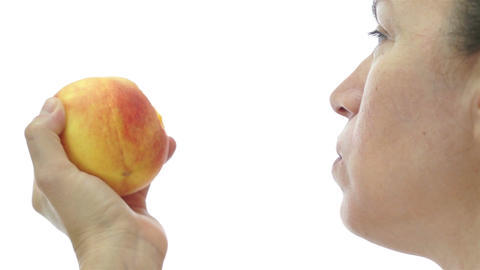 Female Eating Peach Side View stock footage