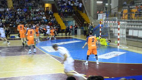 Handball players running and scoring. Good ambient Footage