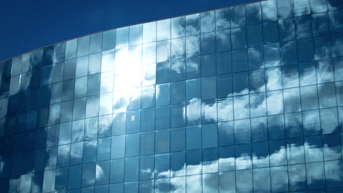 Clouds reflected in office building. 4K Footage