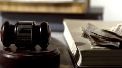Dollars Falling Beside Hammer And Gavel stock footage
