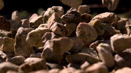 Pebbles falling onto more pebbles Footage