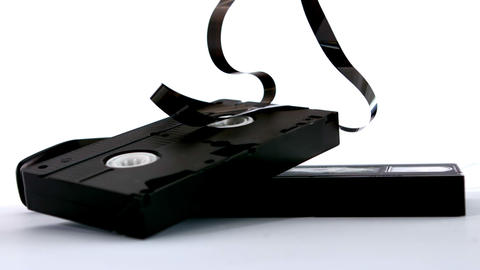Broken Video Tape Falling On White Background stock footage