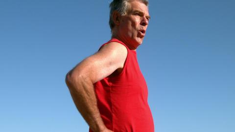 Senior Man Jogging On Sunny Day stock footage