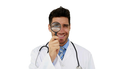 Young doctor looking through magnifying glass Footage